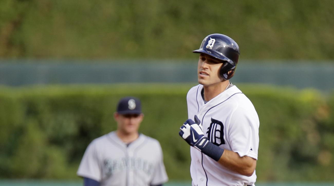 Detroit Tigers' Ian Kinsler, right, rounds the bases past Seattle Mariners shortstop Brad Miller after hitting a solo home run during the first inning of a baseball game Monday, July 20, 2015 in Detroit. (AP Photo/Duane Burleson)