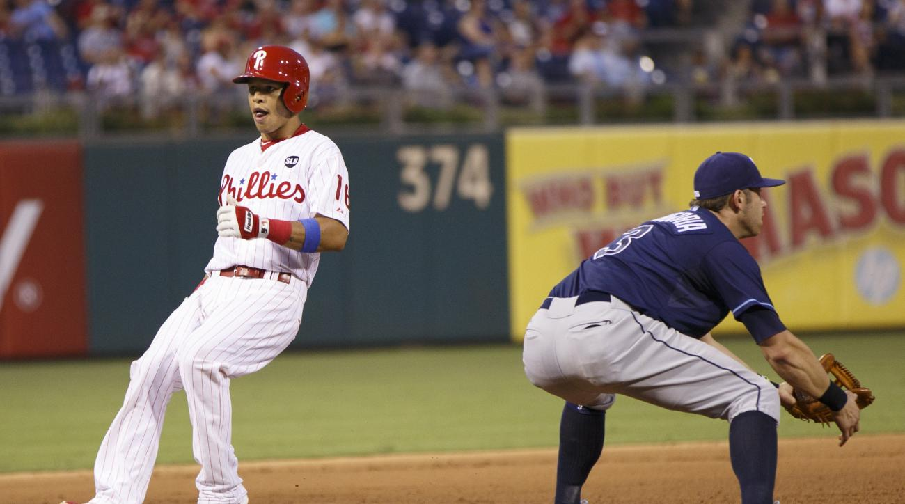 Philadelphia Phillies' Cesar Hernandez, left, reaches third on a triple as Tampa Bay Rays third baseman Evan Longoria, right, waits for the ball during the fifth inning of a baseball game, Monday, July 20, 2015, in Philadelphia. (AP Photo/Chris Szagola)