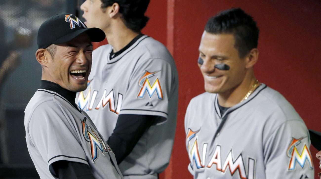 Miami Marlins' Ichiro Suzuki, left, of Japan, laughs along with teammate Derek Dietrich prior to a baseball game against the Arizona Diamondbacks, Monday, July 20, 2015, in Phoenix. (AP Photo/Ross D. Franklin)