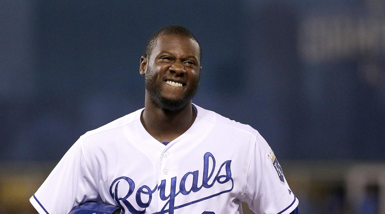 Kansas City Royals' Lorenzo Cain reacts after an out to end the eighth inning of a baseball game against the Pittsburgh Pirates Monday, July 20, 2015, in Kansas City, Mo. (AP Photo/Charlie Riedel)