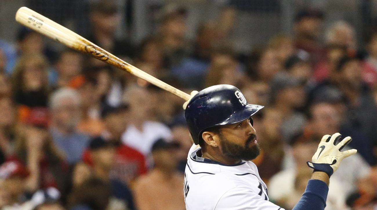 San Diego Padres' Matt Kemp watches his two run homer against the San Francisco Giants in the third inning of a baseball game Monday, July 20, 2015, in San Diego. (AP Photo/Lenny Ignelzi)