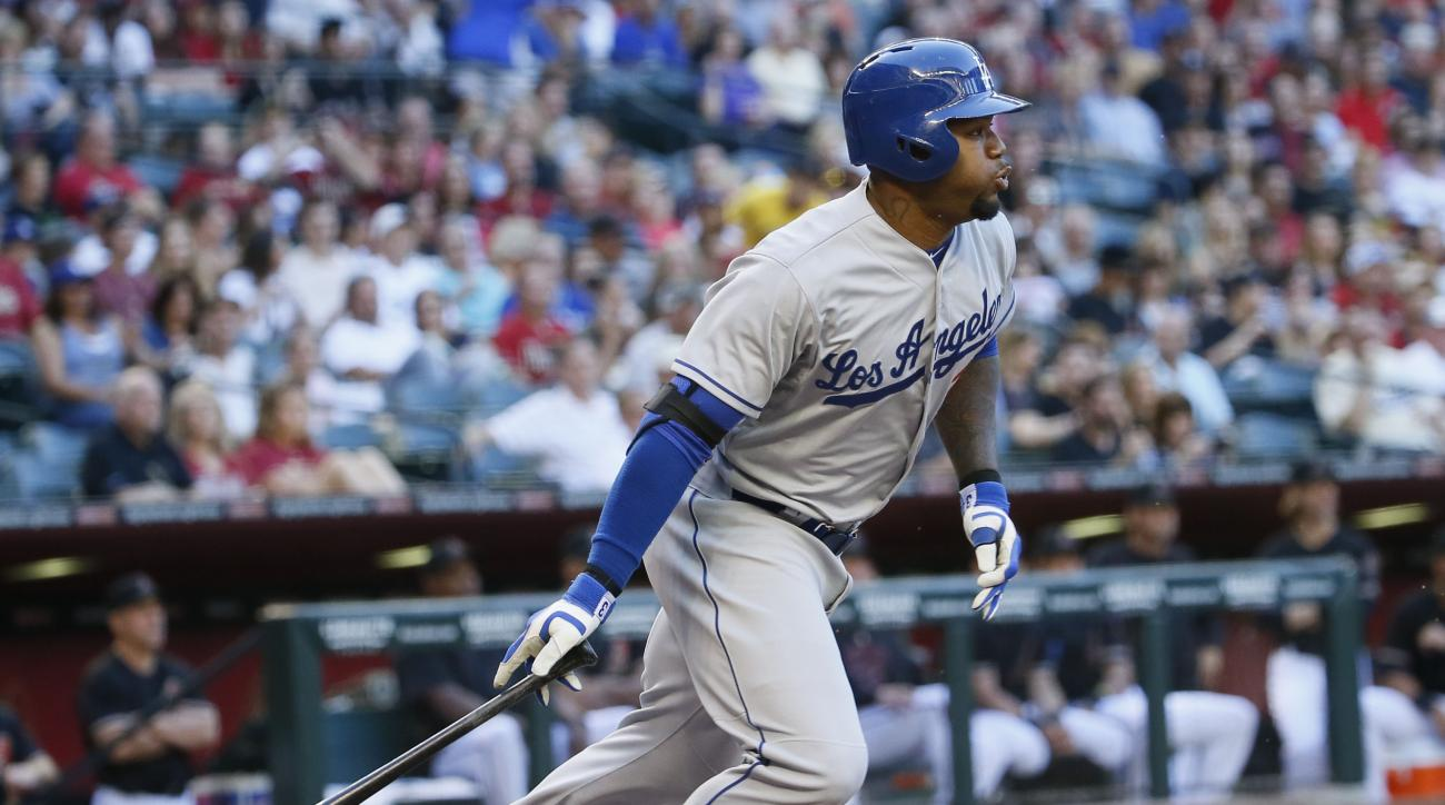 Los Angeles Dodgers Carl Crawford hits against the Arizona Diamondbacks during the first inning of a MLB baseball game, Saturday, April 11, 2015, in Phoenix. (AP Photo/Matt York)