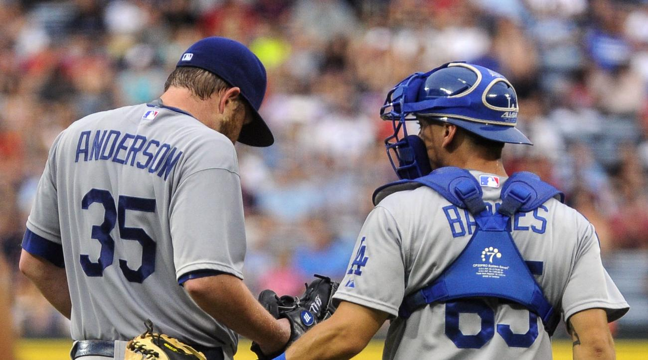Los Angeles Dodgers starting pitcher Brett Anderson (35) gets a visit to the mound by catcher Austin Barnes after allowing two runs to score by the Atlanta Braves during the first inning of a baseball game, Tuesday, July 21, 2015, in Atlanta. (AP Photo/Jo
