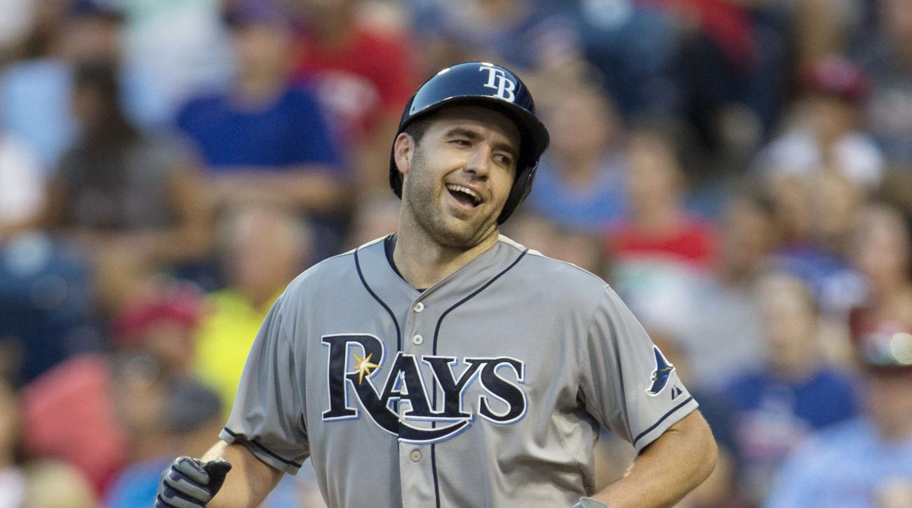 Tampa Bay Rays' Nathan Karns, right, reacts to his solo home run as Philadelphia Phillies catcher Cameron Rupp, left, looks down during the third inning of a baseball game, Tuesday, July 21, 2015, in Philadelphia. (AP Photo/Chris Szagola)