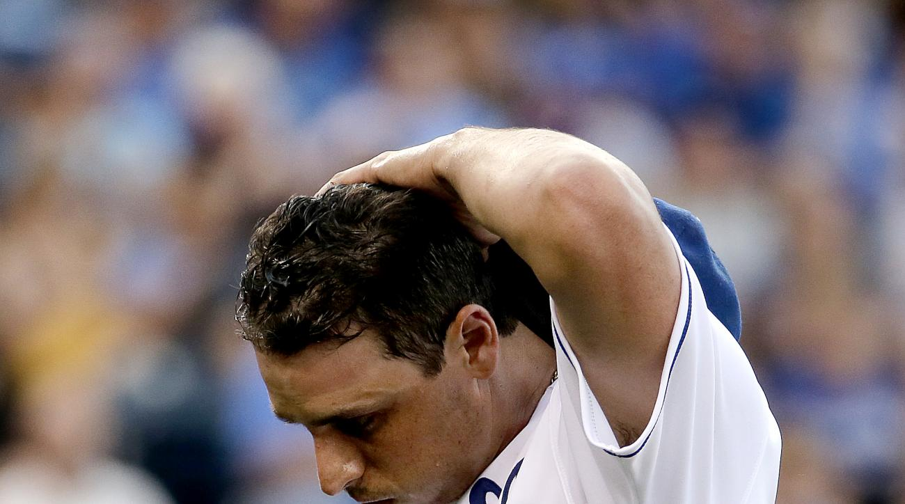 Kansas City Royals starting pitcher Jason Vargas comes out of the game after getting injured during the second inning of a baseball game against the Pittsburgh Pirates Tuesday, July 21, 2015, in Kansas City, Mo. (AP Photo/Charlie Riedel)