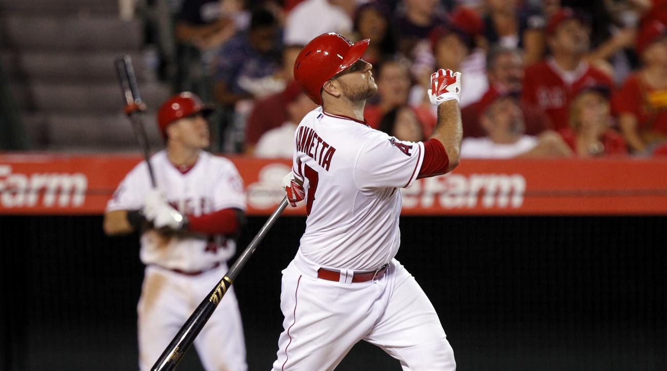 Los Angeles Angels' Chris Iannetta follows through on a three-run home run during the sixth inning of a baseball game against the Minnesota Twins in Anaheim, Calif., Tuesday, July 21, 2015. The Angels won 7-0. (AP Photo/Alex Gallardo)