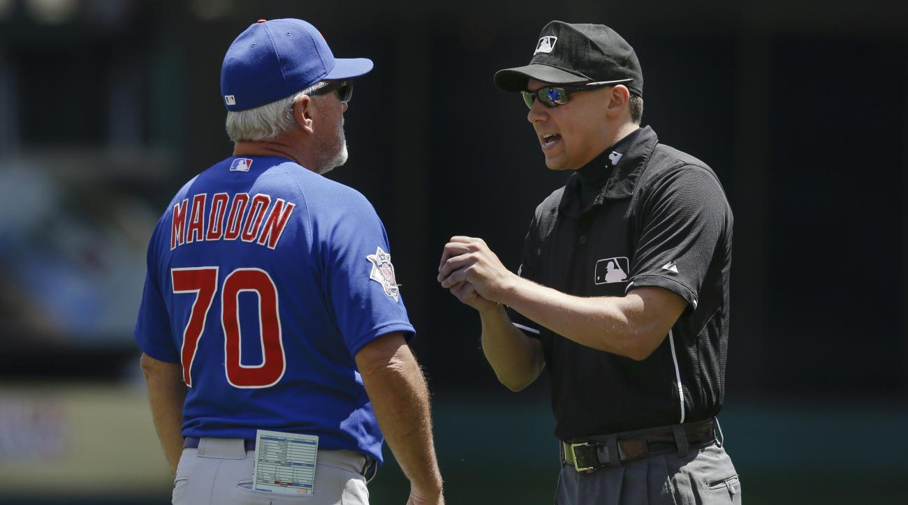 Chicago Cubs manager Joe Maddon (70) is ejected by umpire Adam Hamari for arguing a balk call on starting pitcher Kyle Hendricks in the fourth inning in the first game of a baseball doubeheader against the Cincinnati Reds in Cincinnati, Wednesday, July 22