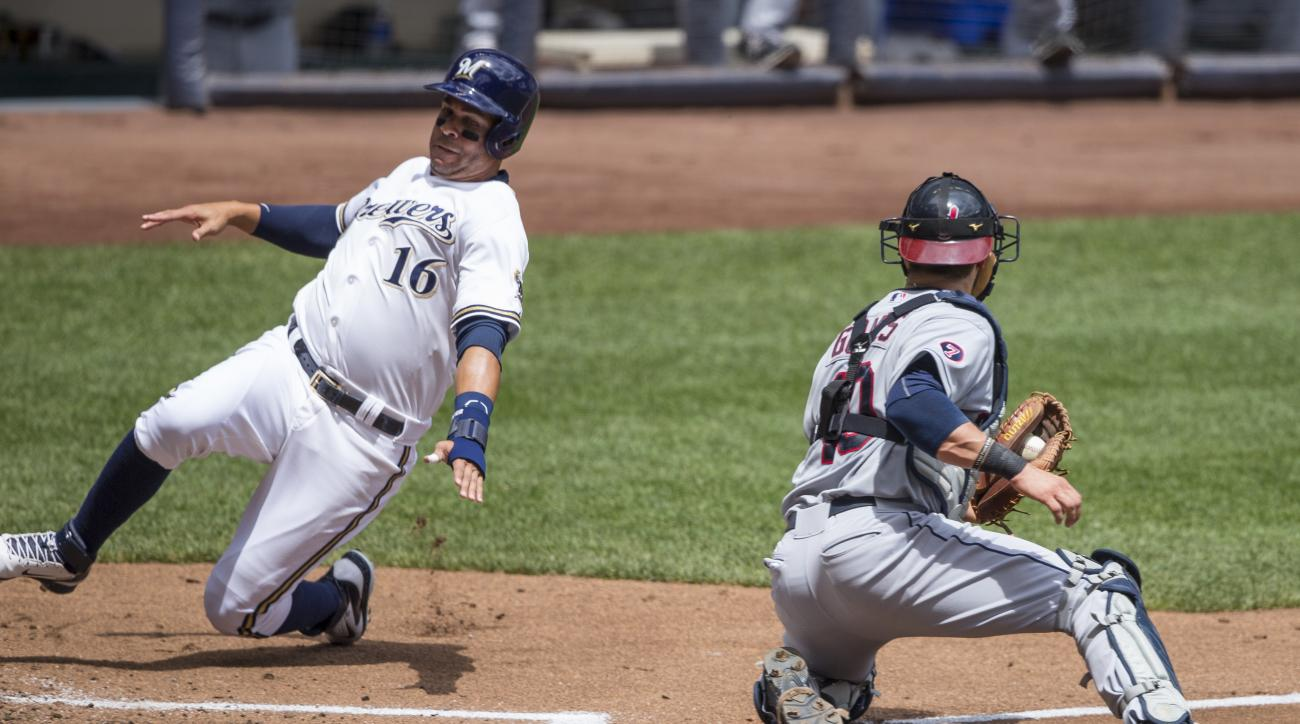 Milwaukee Brewers' Aramis Ramirez (16) slides home safely as Yan Gomes of the Cleveland Indians' is to late to make the tag during the first inning of a baseball game Wednesday, July 22, 2015, in Milwaukee. (AP Photo/Tom Lynn)