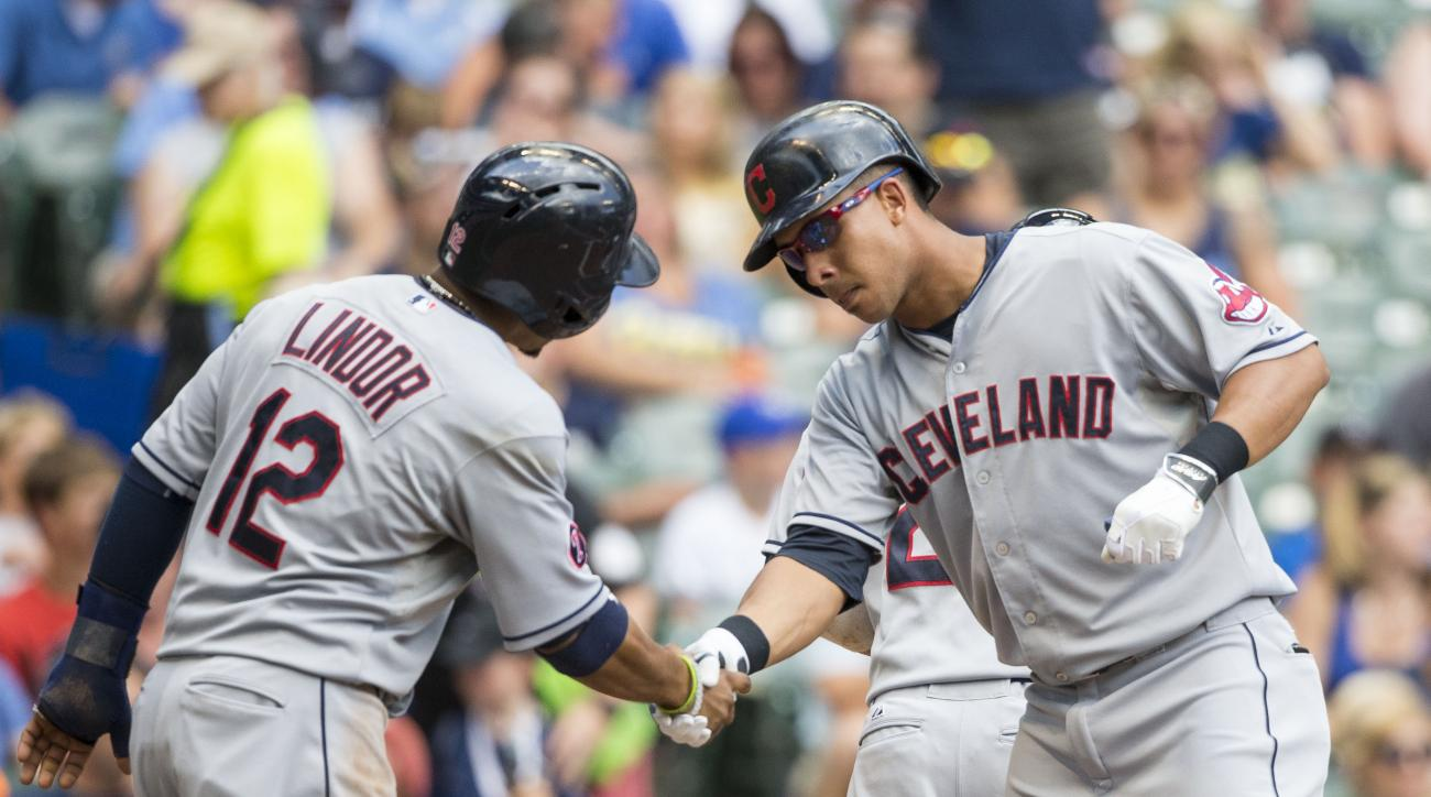 Cleveland Indians' Michael Brantley, right, shakes hands with teammate Francisco Lindor after hitting a three-run hom run off Milwaukee Brewers' Kyle Lohse during the third inning of a baseball game Wednesday, July 22, 2015, in Milwaukee. (AP Photo/Tom Ly