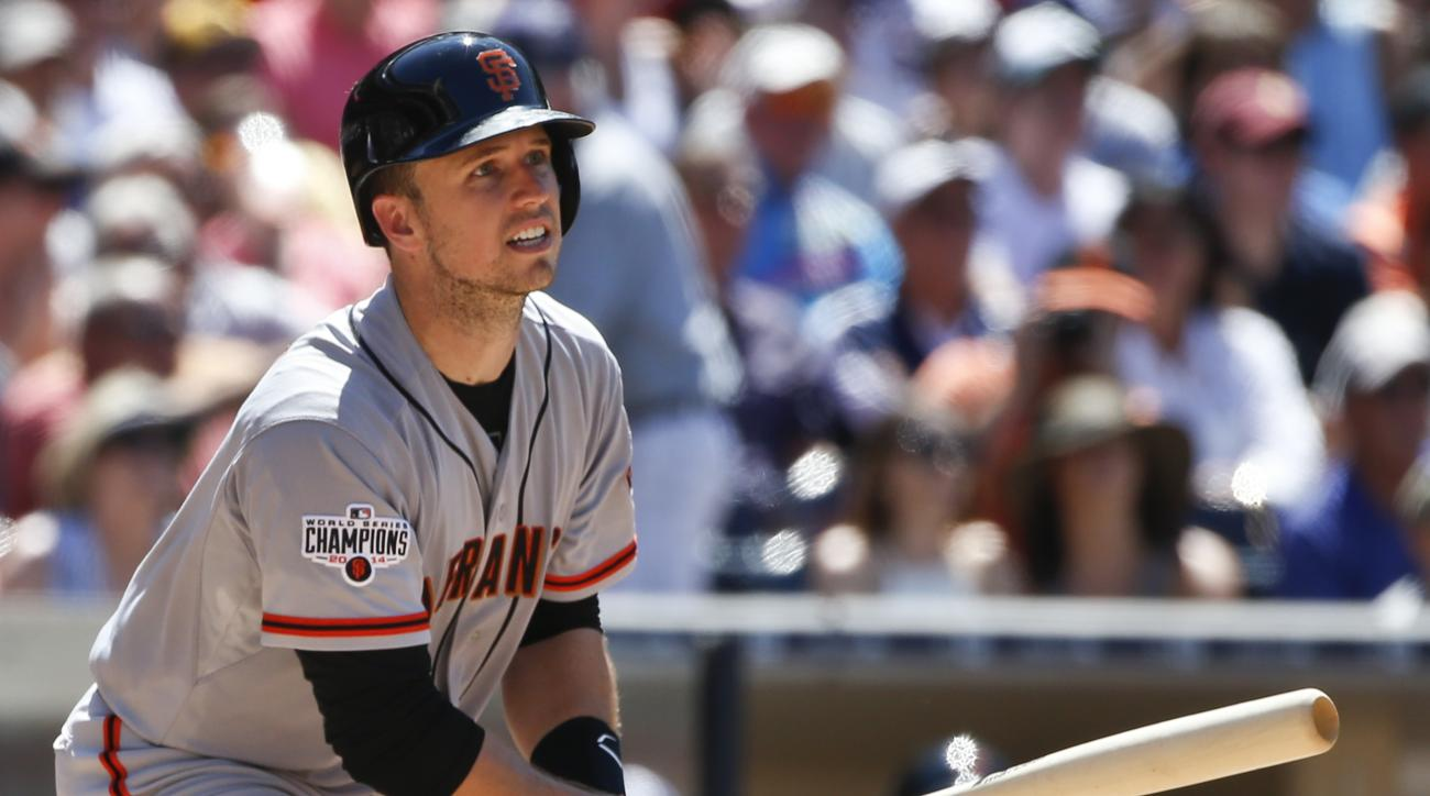 San Francisco Giants' Buster Posey watches the flight of his two run double that fell just fair down the right field line in the seventh inning of a baseball game Wednesday, July 22, 2015, in San Diego. (AP Photo/Lenny Ignelzi)