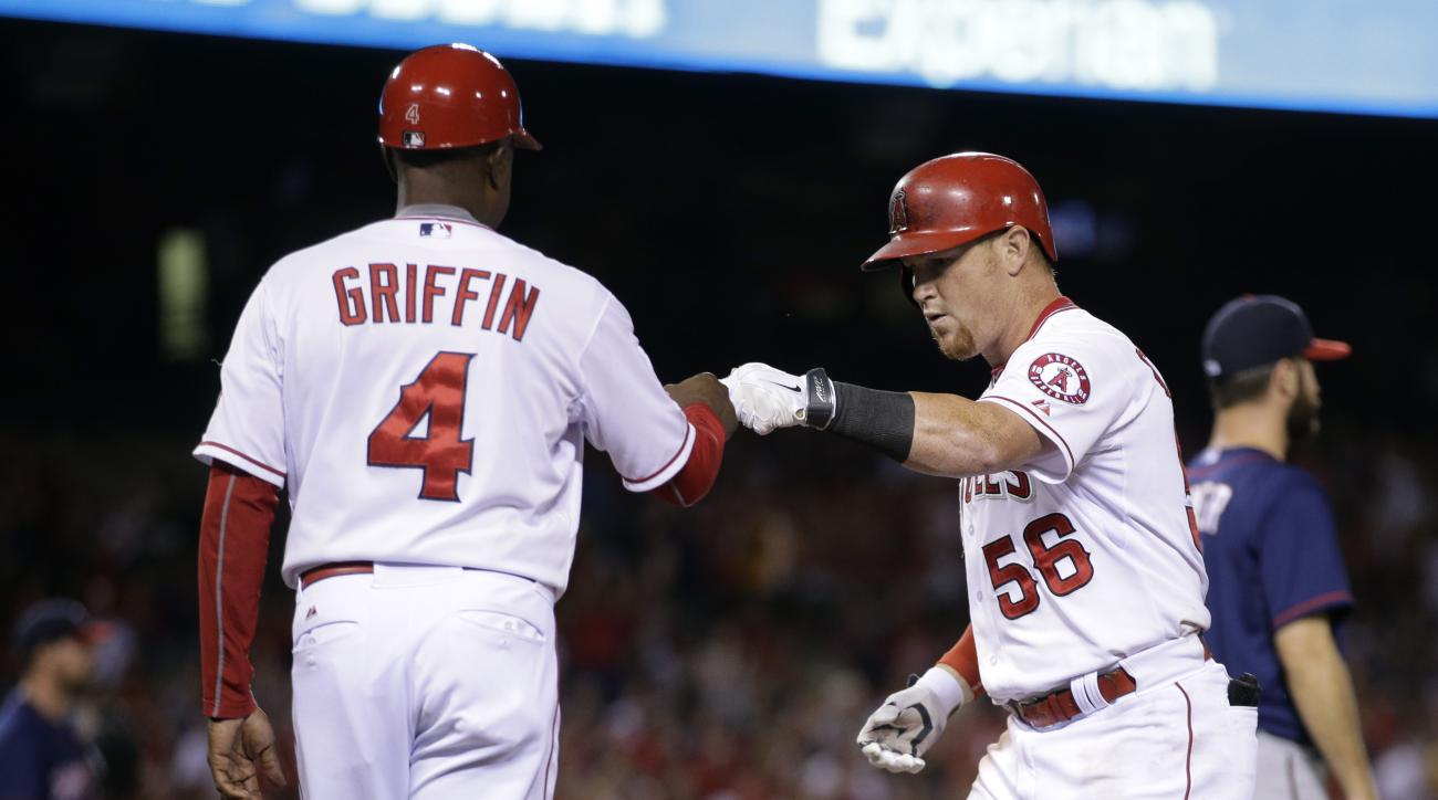 Los Angeles Angels' Kole Calhoun, right, is congratulated by first base coach Alfredo Griffin after hitting an RBI single against the Minnesota Twins during the fifth inning of a baseball game, Wednesday, July 22, 2015, in Anaheim, Calif. (AP Photo/Jae C.