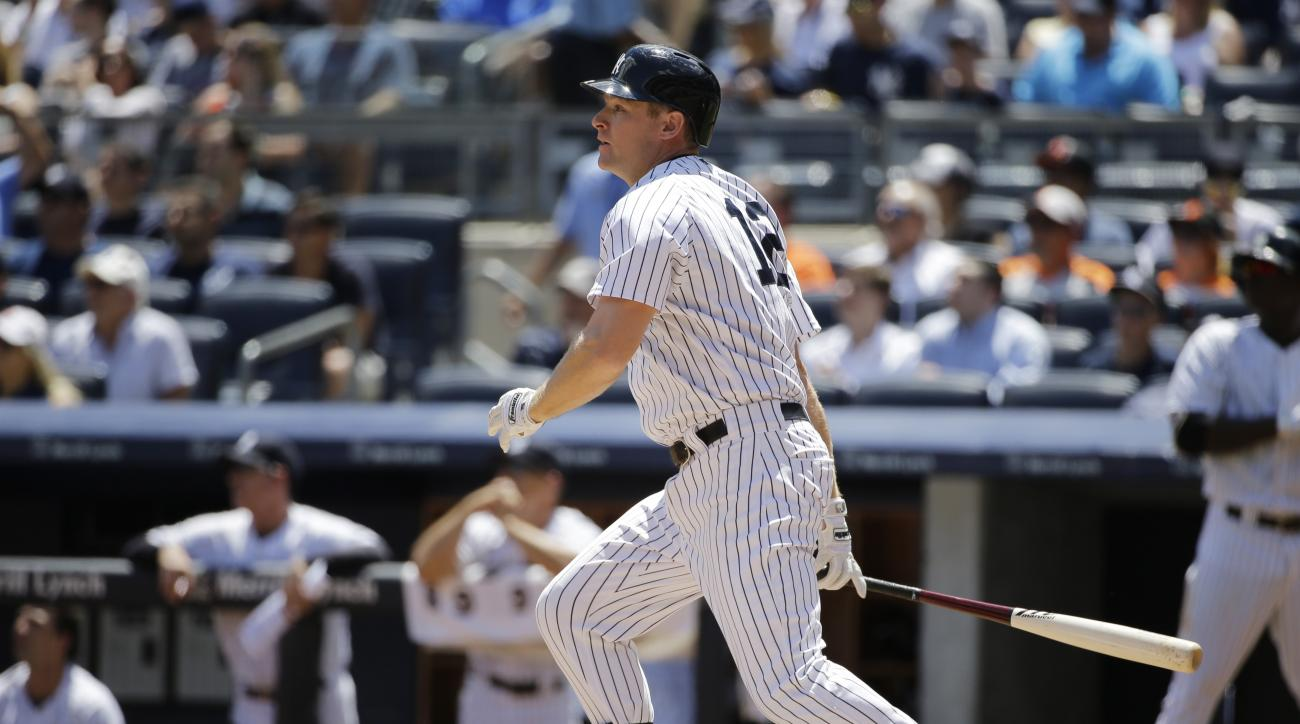 New York Yankees' Chase Headley watches his first-inning, three-run double in a baseball game against the Baltimore Orioles at Yankee Stadium in New York, Thursday, July 23, 2015.  (AP Photo/Kathy Willens)