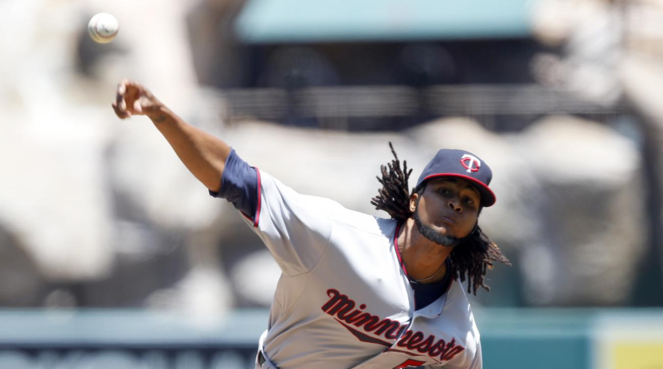 Minnesota Twins starting pitcher Ervin Santana throws against the Los Angeles Angels during the first inning of a baseball game in Anaheim, Calif., Thursday, July 23, 2015. (AP Photo/Alex Gallardo)