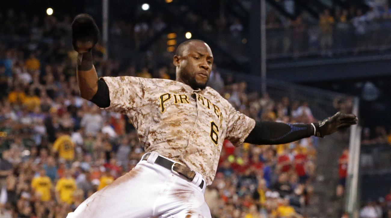 Pittsburgh Pirates' Starling Marte scores on a double by Jung Ho Kang during the fifth inning of a baseball game against the Washington Nationals in Pittsburgh, Thursday, July 23, 2015. (AP Photo/Gene J. Puskar)