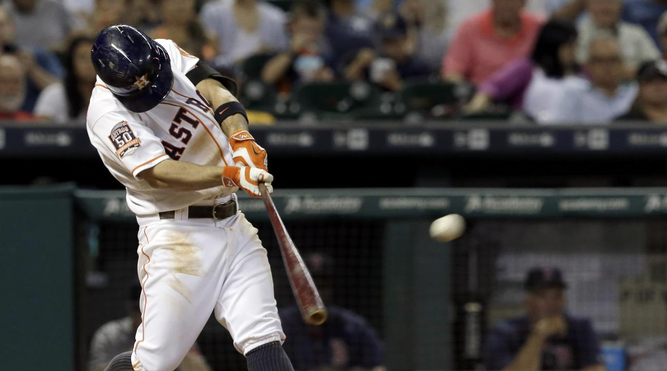 Houston Astros' Jose Altuve connects for a double against the Boston Red Sox in the fifth inning of a baseball game Thursday, July 23, 2015, in Houston. (AP Photo/Pat Sullivan)