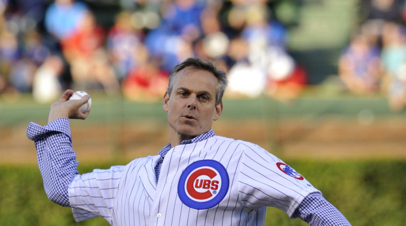 Colin Cowherd, of ESPN radio, tosses out the first pitch before the Cincinnati Reds' baseball game against the Chicago Cubs on Tuesday, Aug. 13, 2013, in Chicago. (AP Photo/Jim Prisching)