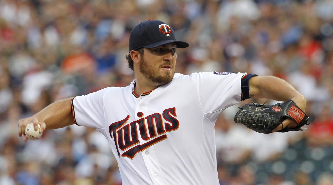 Minnesota Twins starting pitcher Phil Hughes delivers to the New York Yankees during the first inning of a baseball game in Minneapolis, Friday, July 24, 2015. (AP Photo/Ann Heisenfelt)