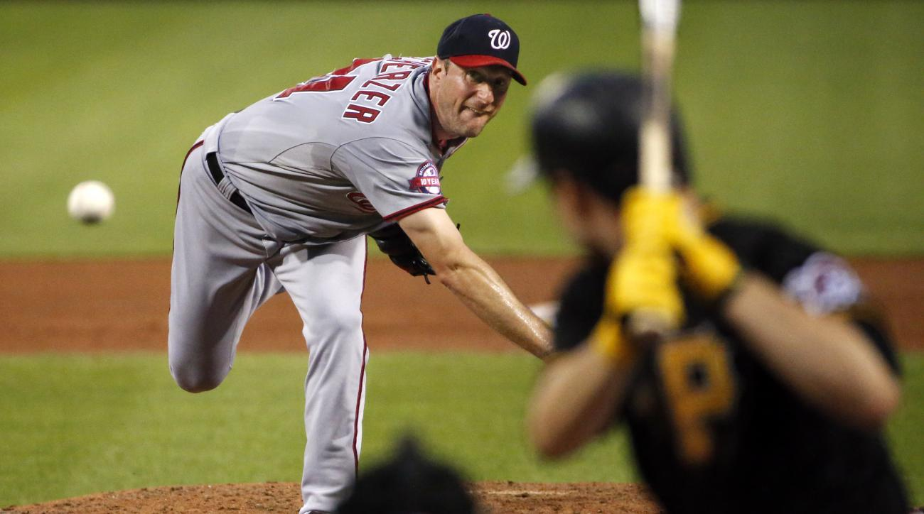 Washington Nationals starting pitcher Max Scherzer, left, delivers to Pittsburgh Pirates' Neil Walker in the fifth inning of a baseball game in Pittsburgh, Friday, July 24, 2015. Walker hit this pitch for a solo-home run. (AP Photo/Gene J. Puskar)