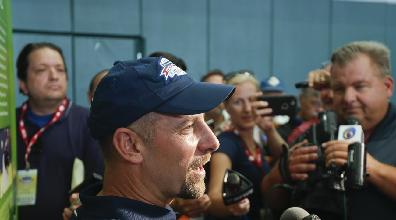 National Baseball Hall of Fame electee John Smoltz talks to members of the media during a news conference on Saturday, July 25, 2015, in Cooperstown, N.Y. Smoltz will be inducted to the hall on Sunday. (AP Photo/Mike Groll)