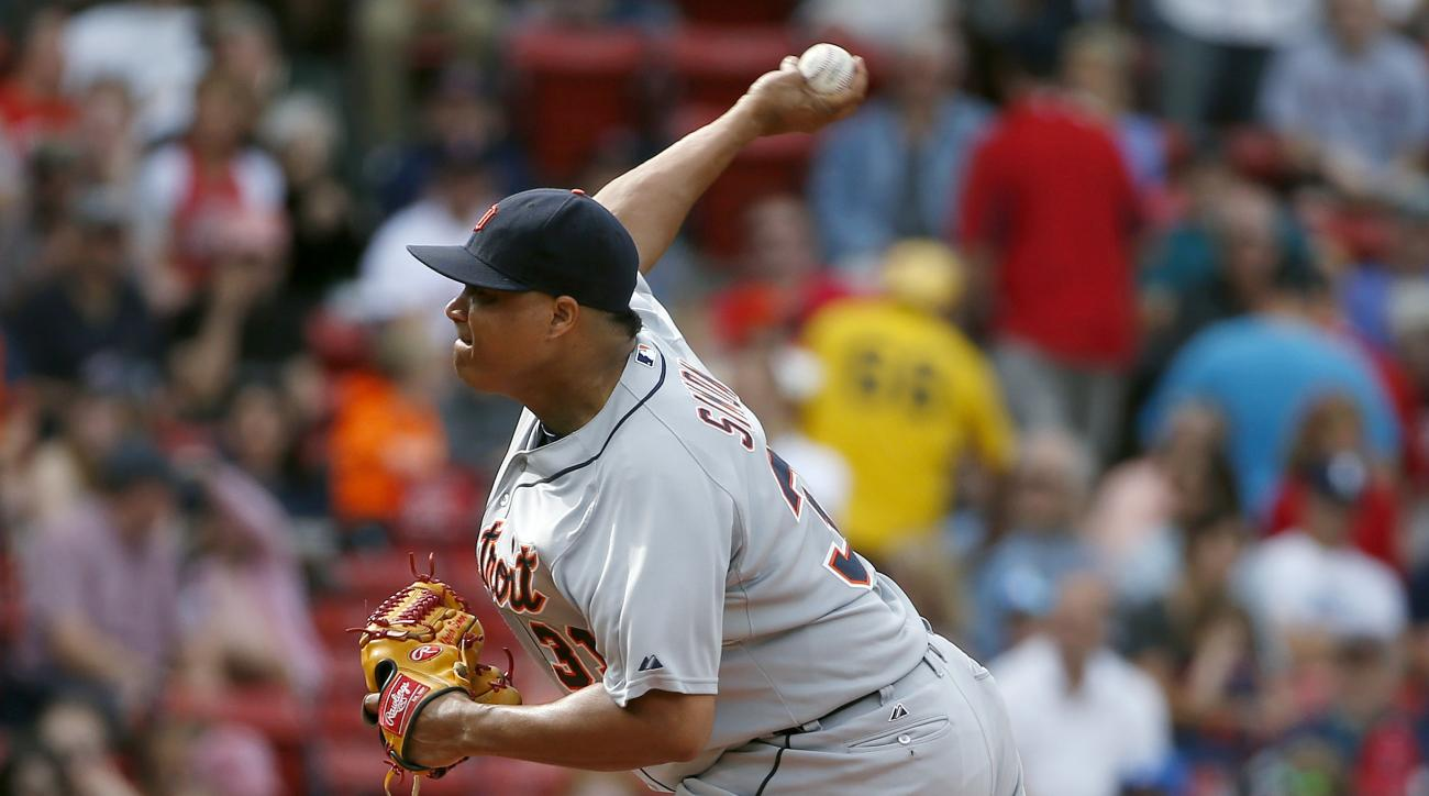 Detroit Tigers' Alfredo Simon pitches during the first inning of a baseball game against the Boston Red Sox in Boston, Saturday, July 25, 2015. (AP Photo/Michael Dwyer)