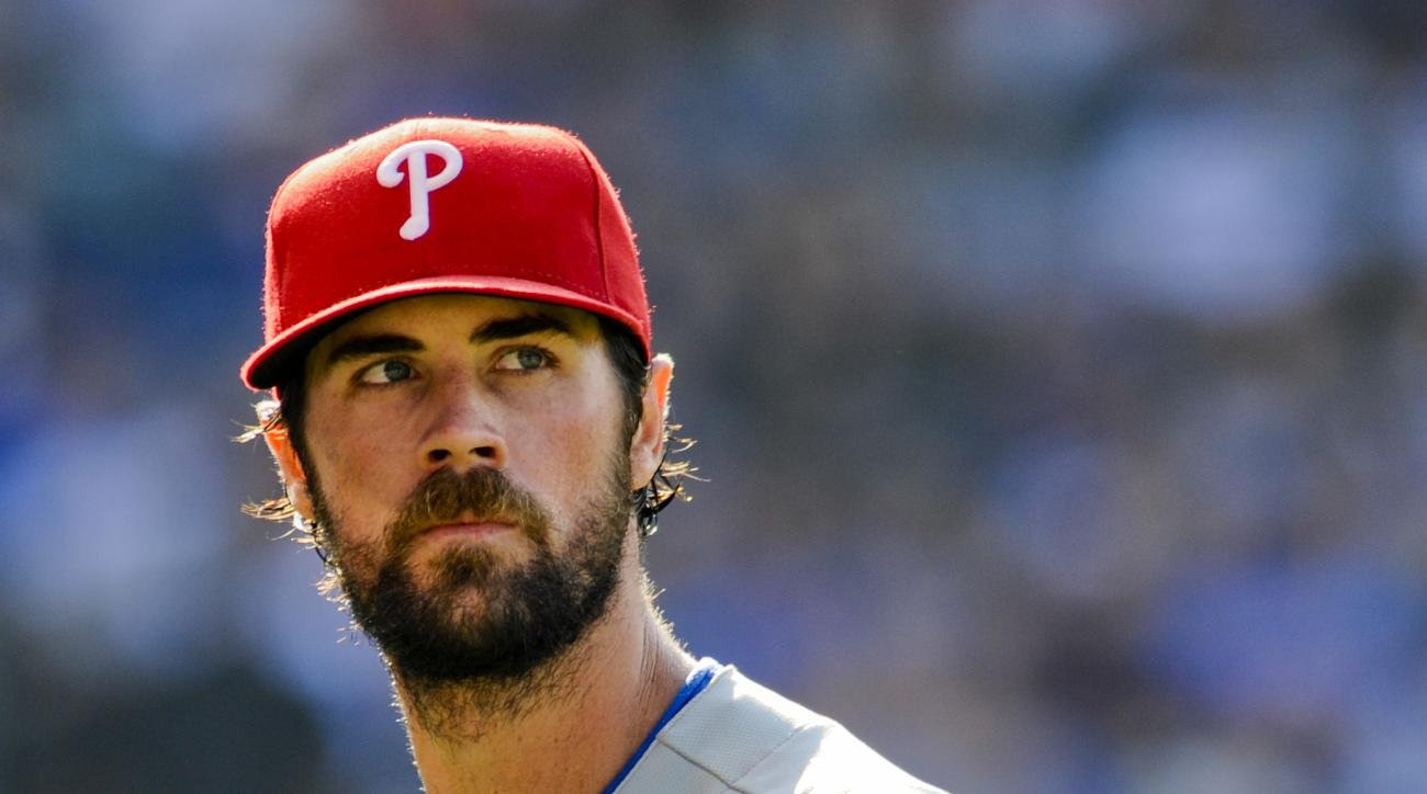 Philadelphia Phillies' starting pitcher Cole Hamels looks on after pitching the seventh inning of baseball game against the Chicago Cubs in Chicago, Saturday, July 25, 2015. (AP Photo/Matt Marton)