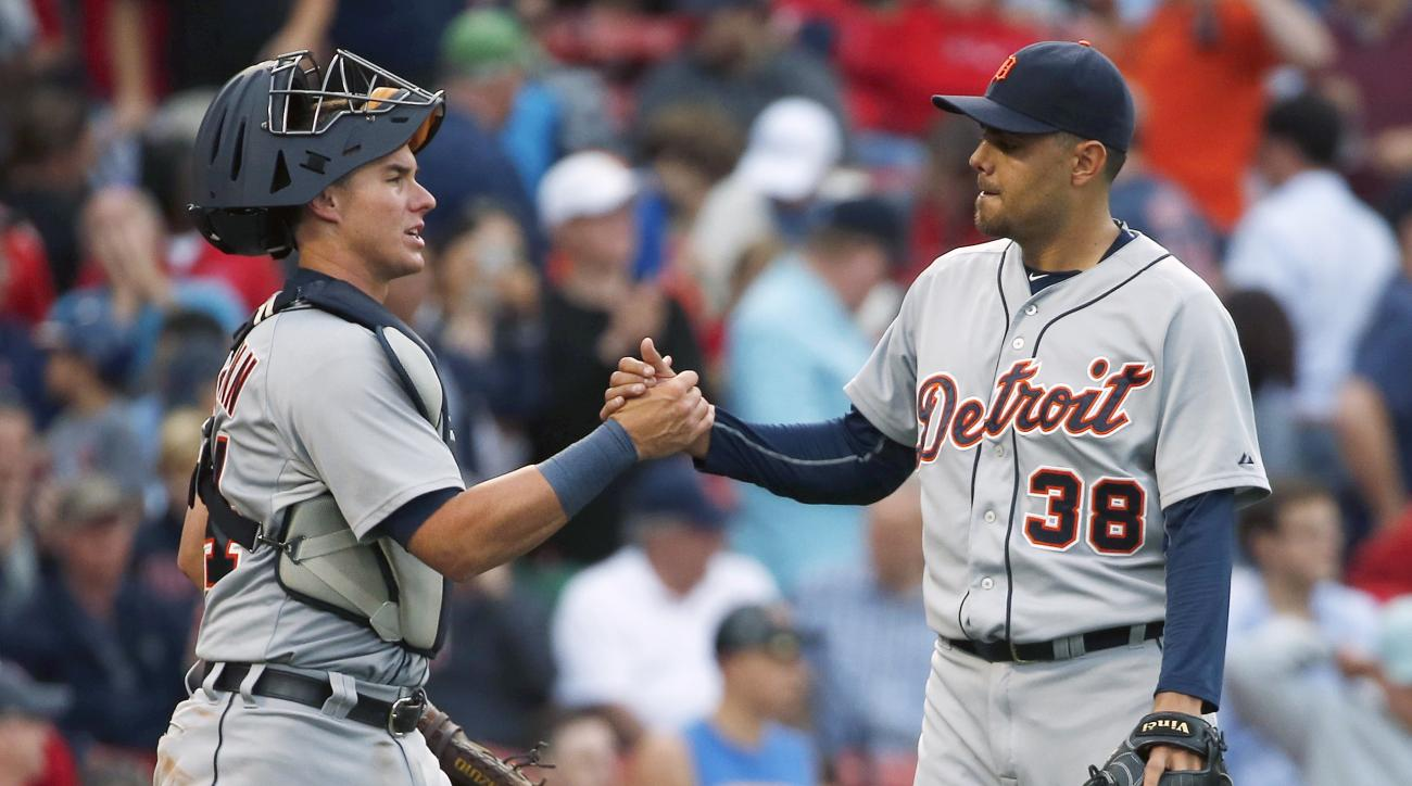 Detroit Tigers' James McCann, left, and Joakim Soria (38) celebrate after the Tigers defeated the Boston Red Sox 5-1 in a baseball game in Boston, Saturday, July 25, 2015. (AP Photo/Michael Dwyer)