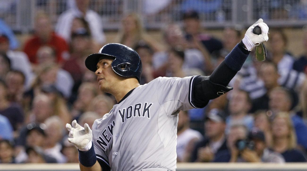 New York Yankees' Alex Rodriguez follows through on a solo home run off Minnesota Twins relief pitcher Glen Perkins during the ninth inning of a baseball game in Minneapolis, Saturday, July 25, 2015. The Yankees won 8-5. (AP Photo/Ann Heisenfelt)