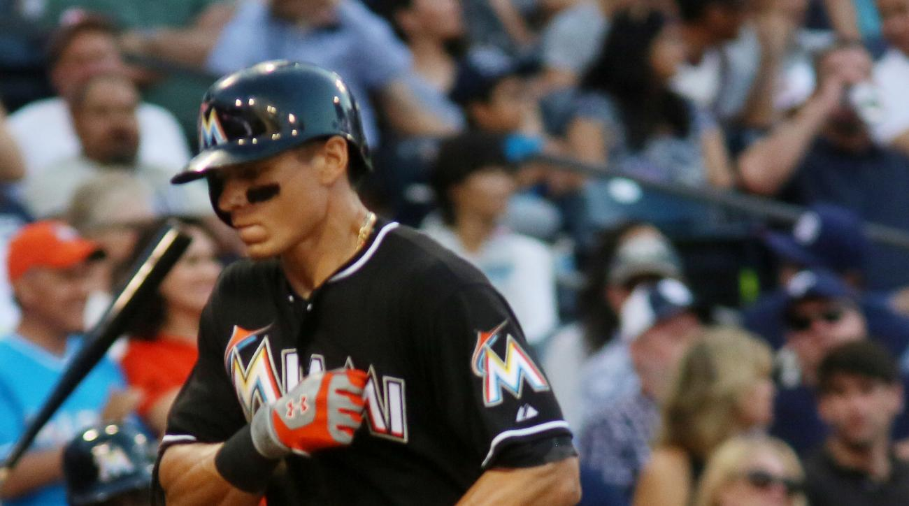 Miami Marlins' Derek Dietrich scores a run in the seventh inning against the San Diego Padres during a baseball game Saturday, July 25, 2015, in San Diego. (AP Photo/Sandy Huffaker)