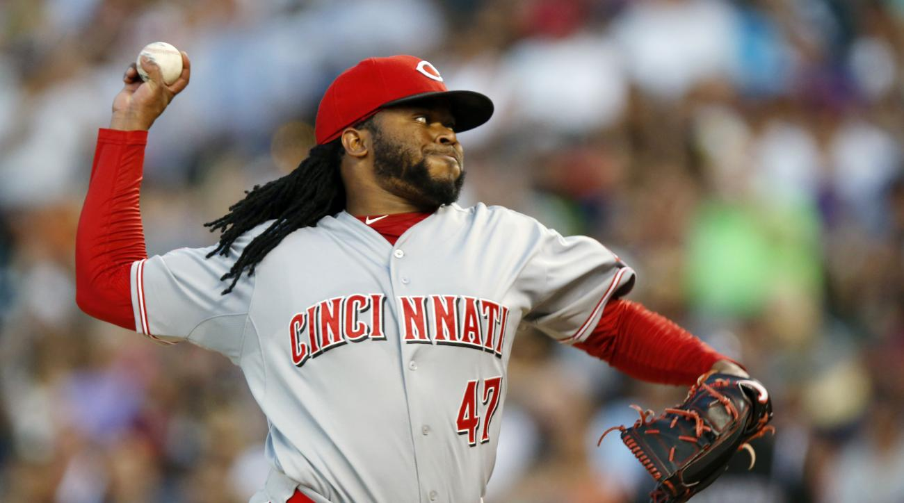 Cincinnati Reds starting pitcher Johnny Cueto works against the Colorado Rockies in the seventh inning of a baseball game Saturday, July 25, 2015, in Denver. Cincinnati won 5-2. (AP Photo/David Zalubowski)