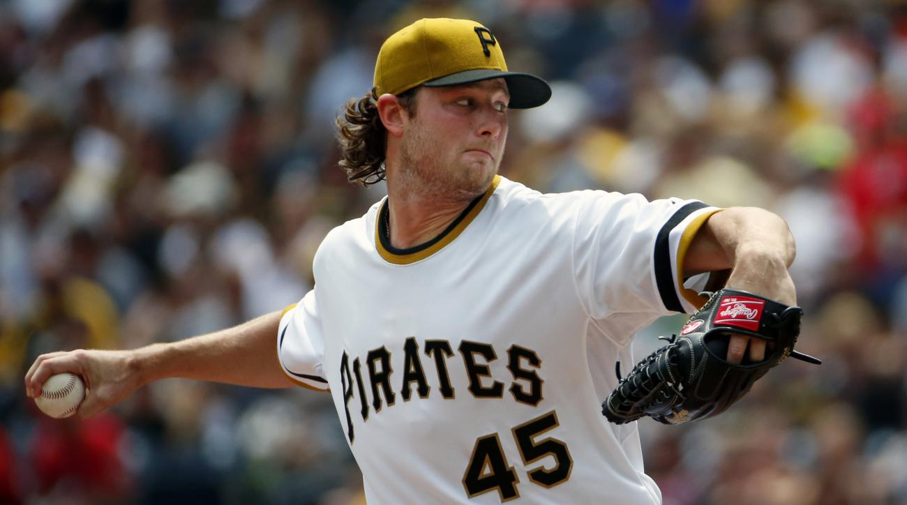 Pittsburgh Pirates' Gerrit Cole delivers in the first inning of a baseball game against the Washington Nationals in Pittsburgh, Sunday, July 26, 2015. (AP Photo/Gene J. Puskar)
