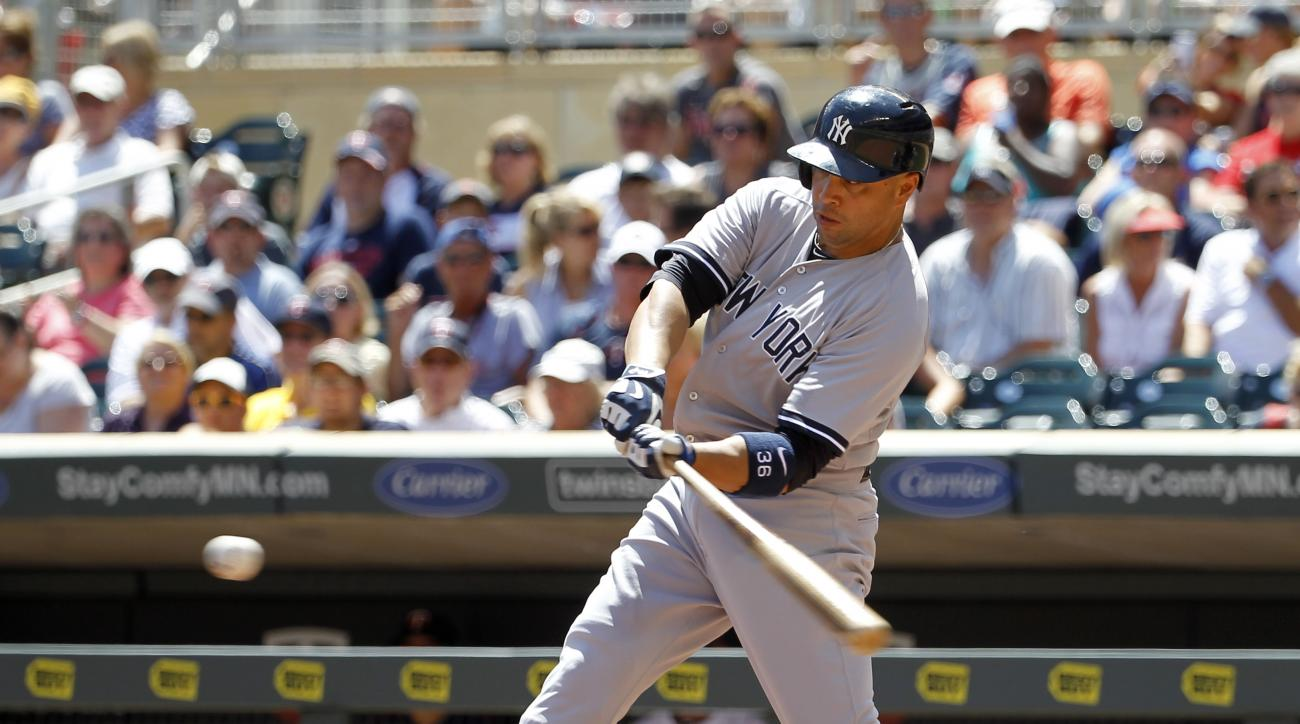 New York Yankees'  Carlos Beltran swings for a double during the first inning of a baseball game in Minneapolis, Sunday, July 26, 2015.  (AP Photo/Ann Heisenfelt)