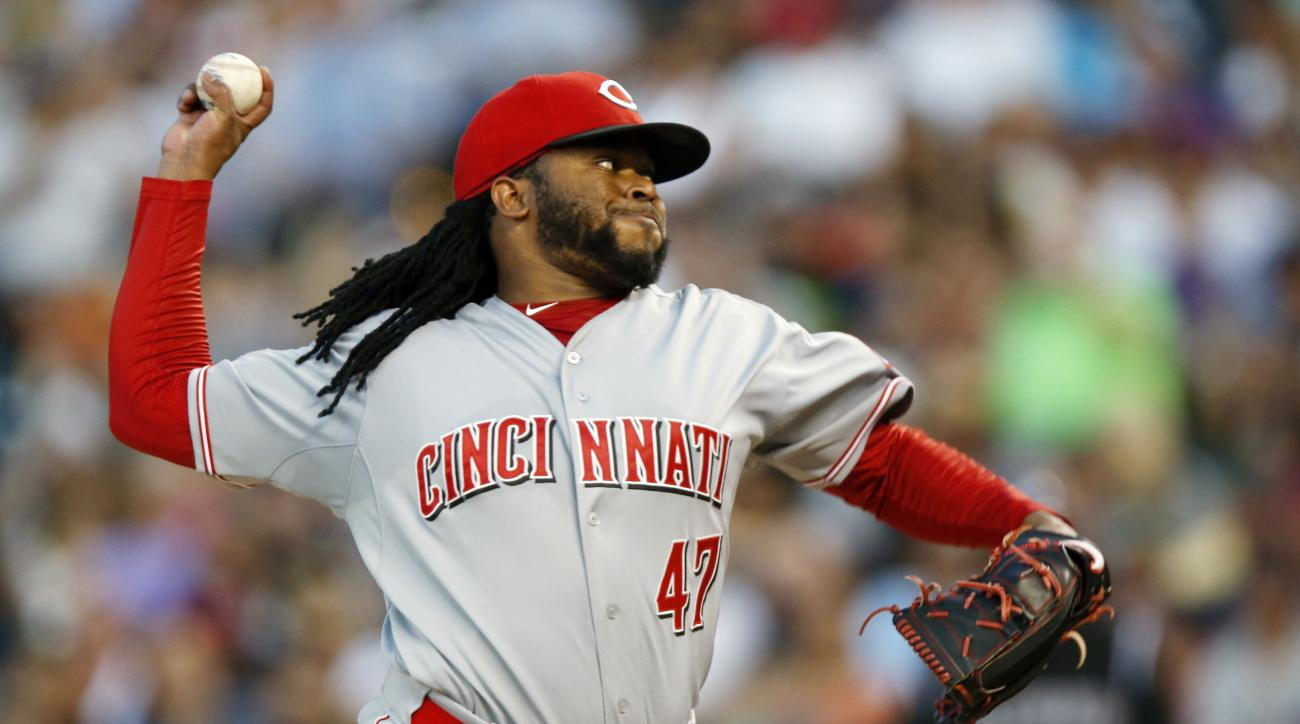 FILE - In this July 25, 2015, file photo, Cincinnati Reds starting pitcher Johnny Cueto works against the Colorado Rockies in the seventh inning of a baseball game Saturday in Denver. The Kansas City Royals acquired Cueto in a trade with Cincinnati on Sun