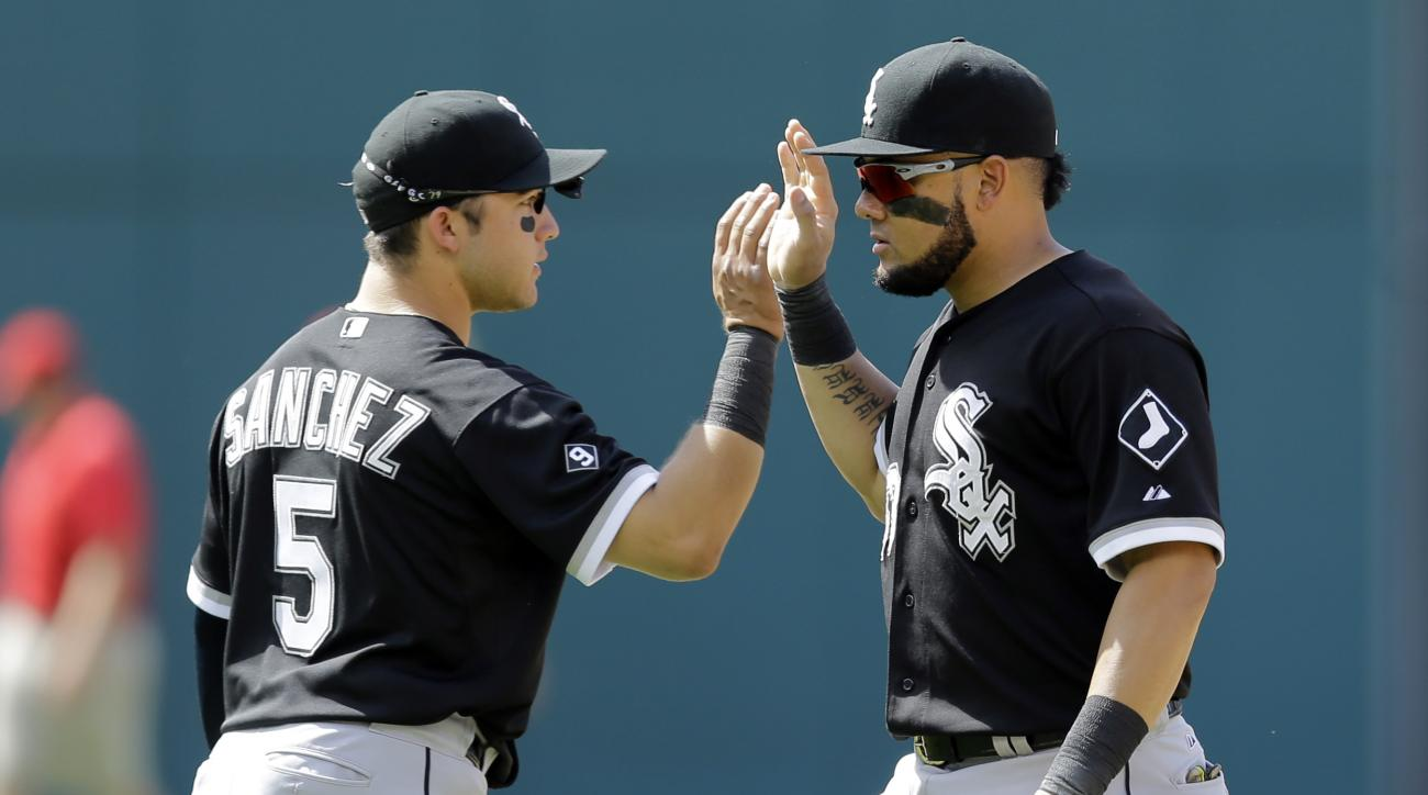 Chicago White Sox's Melky Cabrera, right, and Carlos Sanchez celebrate after the White Sox defeated the Cleveland Indians 2-1 in a baseball game, Sunday, July 26, 2015, in Cleveland. (AP Photo/Tony Dejak)