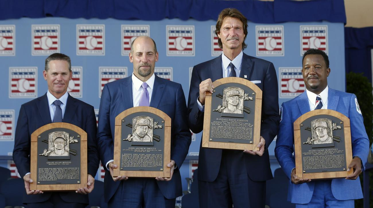 Newly-inducted National Baseball Hall of Famers from left to right, Craig Biggio, John Smoltz, Randy Johnson and Pedro Martinez hold their plaques after an induction ceremony at the Clark Sports Center on Sunday, July 26, 2015, in Cooperstown, N.Y. (AP Ph