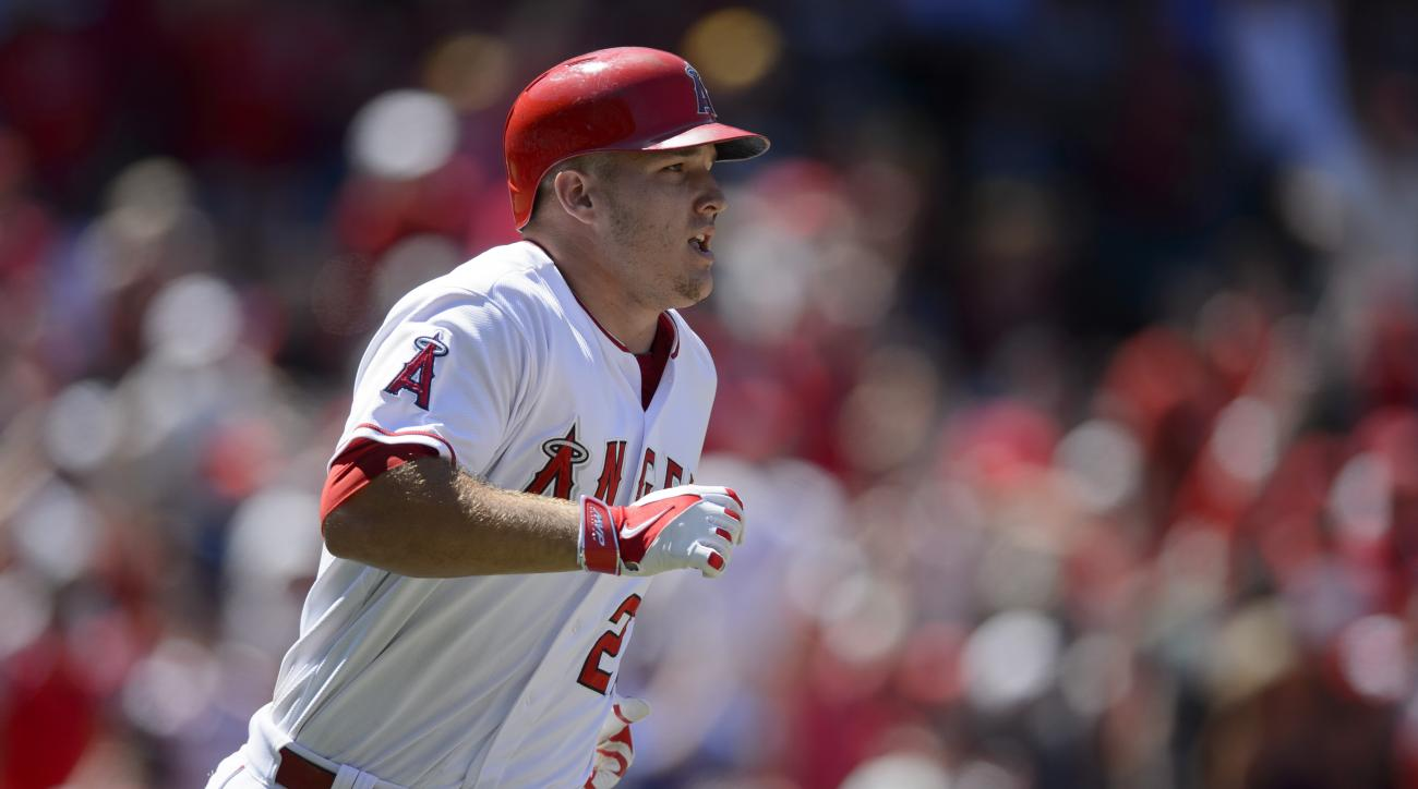 Los Angeles Angels' Mike Trout runs toward first base after hitting a grand slam home run off of Texas Rangers pitcher Spencer Patton, not pictured, during the sixth inning of a baseball game in Anaheim, Calif., Sunday, July 26, 2015. (AP Photo/Kelvin Kuo