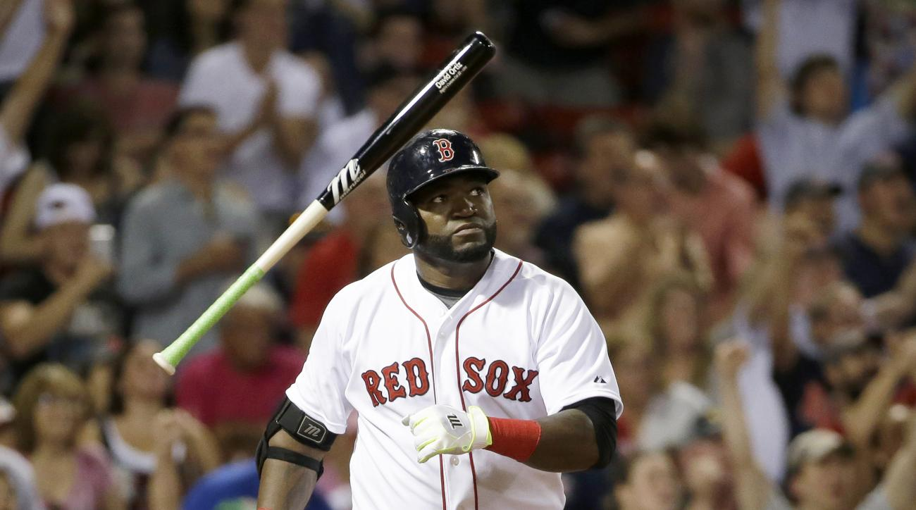 Boston Red Sox's David Ortiz tosses the bat as he watches the flight of his three-run home run in the fifth inning of a baseball game against the Detroit Tigers at Fenway Park, Sunday, July 26, 2015, in Boston. (AP Photo/Steven Senne)