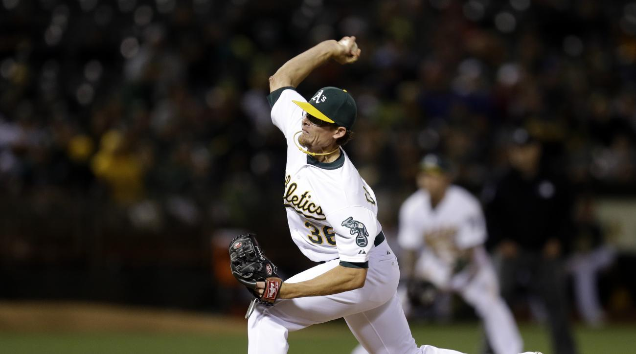 Oakland Athletics pitcher Tyler Clippard works against the Toronto Blue Jays in the ninth inning of a baseball game Wednesday, July 22, 2015, in Oakland, Calif. (AP Photo/Ben Margot)