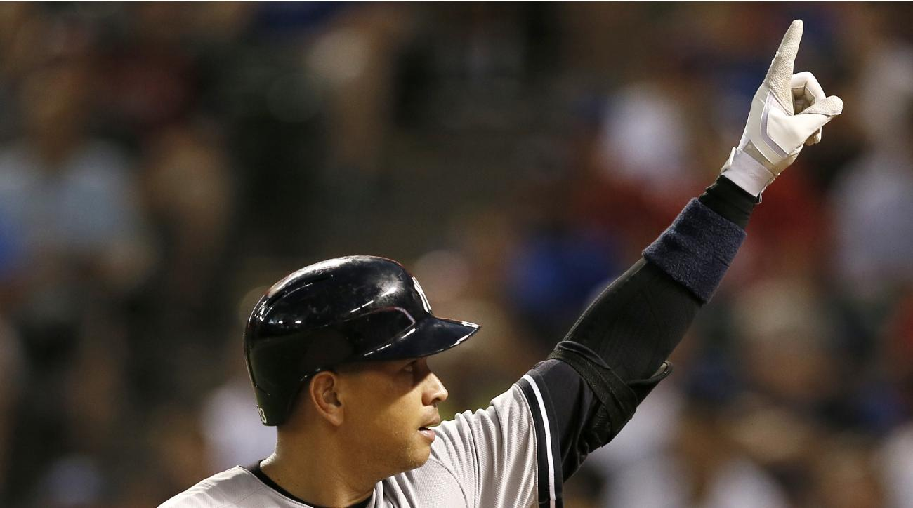 New York Yankees' Alex Rodriguez celebrates his solo home run as he jogs back to the dugout in the sixth inning of a baseball game against the Texas Rangers, Monday, July 27, 2015, in Arlington, Texas. (AP Photo/Tony Gutierrez)