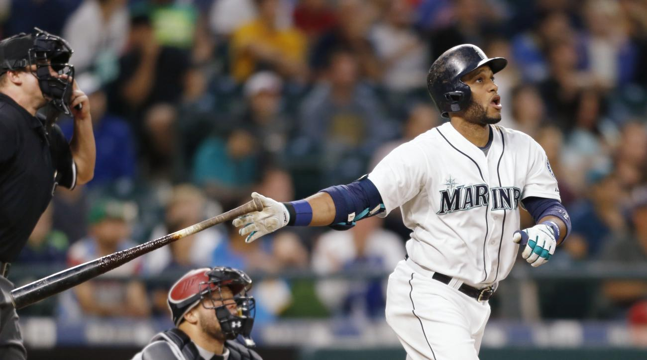 Seattle Mariners' Robinson Cano hits a solo home run on a pitch from Arizona Diamondbacks' Robbie Ray during the sixth inning of a baseball game on Monday, July 27, 2015, in Seattle. (AP Photo/John Froschauer)
