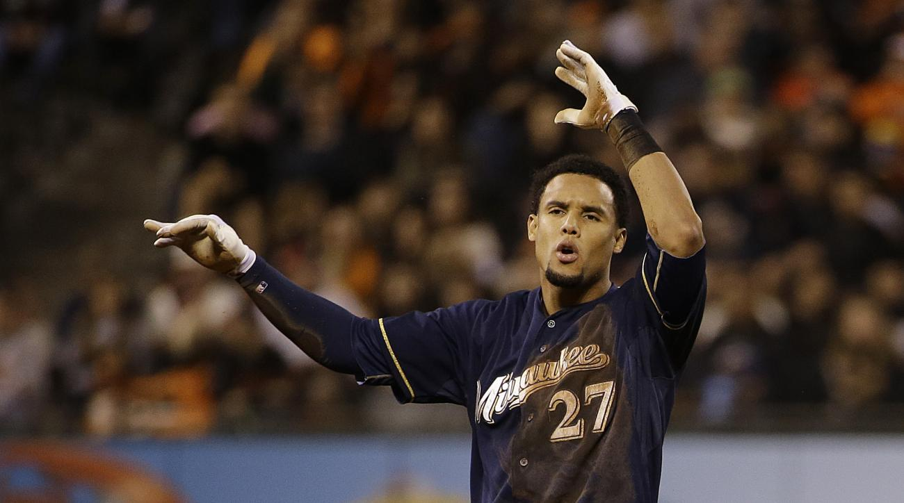 Milwaukee Brewers' Carlos Gomez (27) throws his helmet after an officials' review called him out stealing second during the ninth inning of a baseball game against the San Francisco Giants, Monday, July 27, 2015, in San Francisco. The Giants won 4-2. (AP