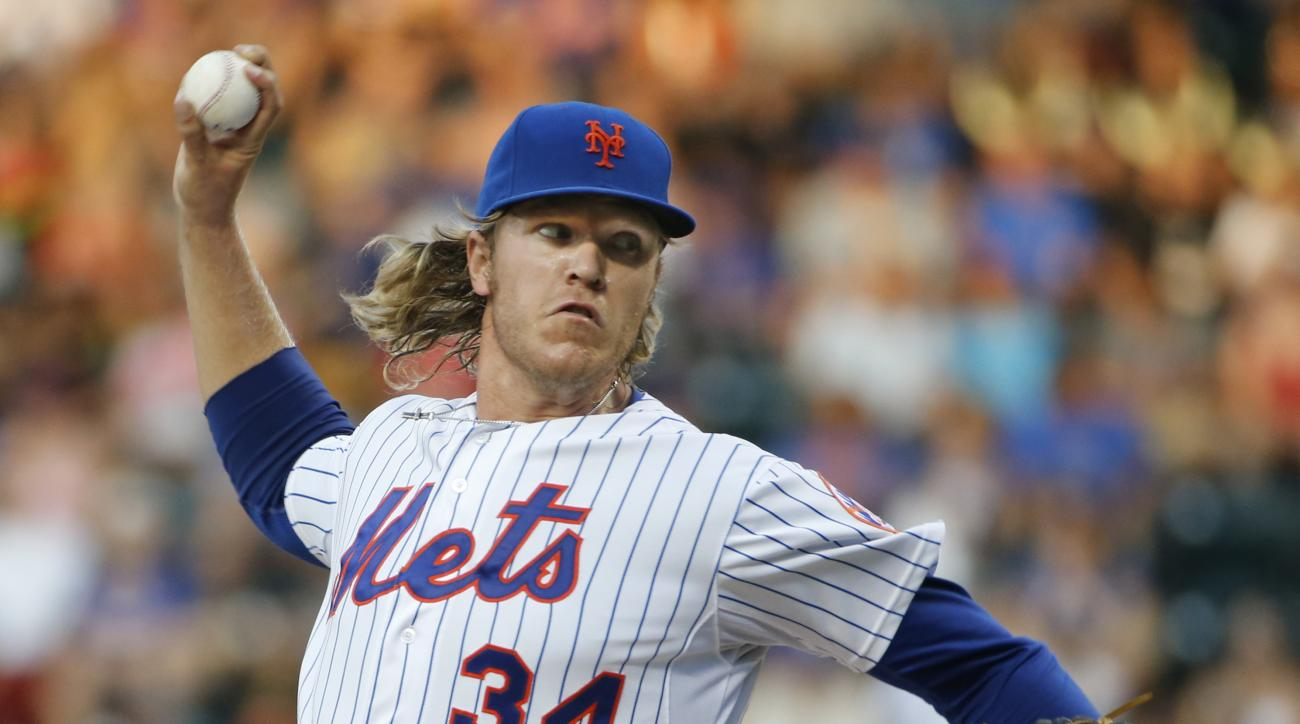 New York Mets starting pitcher Noah Syndergaard (34) delivers in the first inning of a baseball game against the San Diego Padres in New York, Tuesday, July 28, 2015. (AP Photo/Kathy Willens)