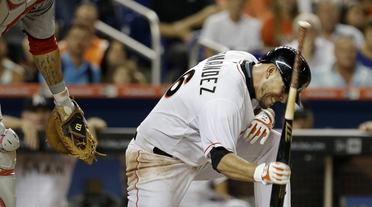 Miami Marlins' Jose Fernandez reacts after striking out against Washington Nationals pitcher Jordan Zimmermann in the fifth inning of a baseball game, Tuesday, July 28, 2015, in Miami. (AP Photo/Alan Diaz)