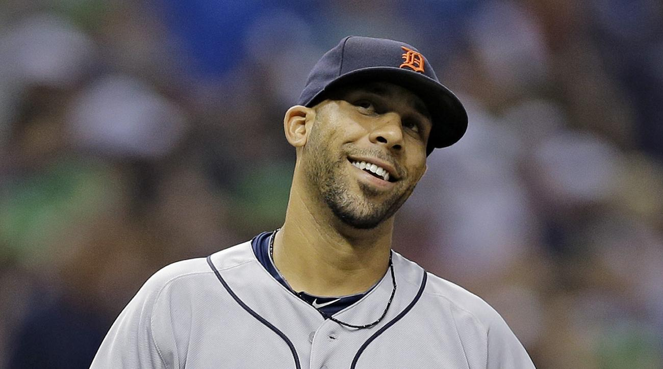 Detroit Tigers starting pitcher David Price reacts after Tampa Bay Rays' Curt Casali hit a solo home run, his second of the game, during the sixth inning of a baseball game Tuesday, July 28, 2015, in St. Petersburg, Fla.  (AP Photo/Chris O'Meara)