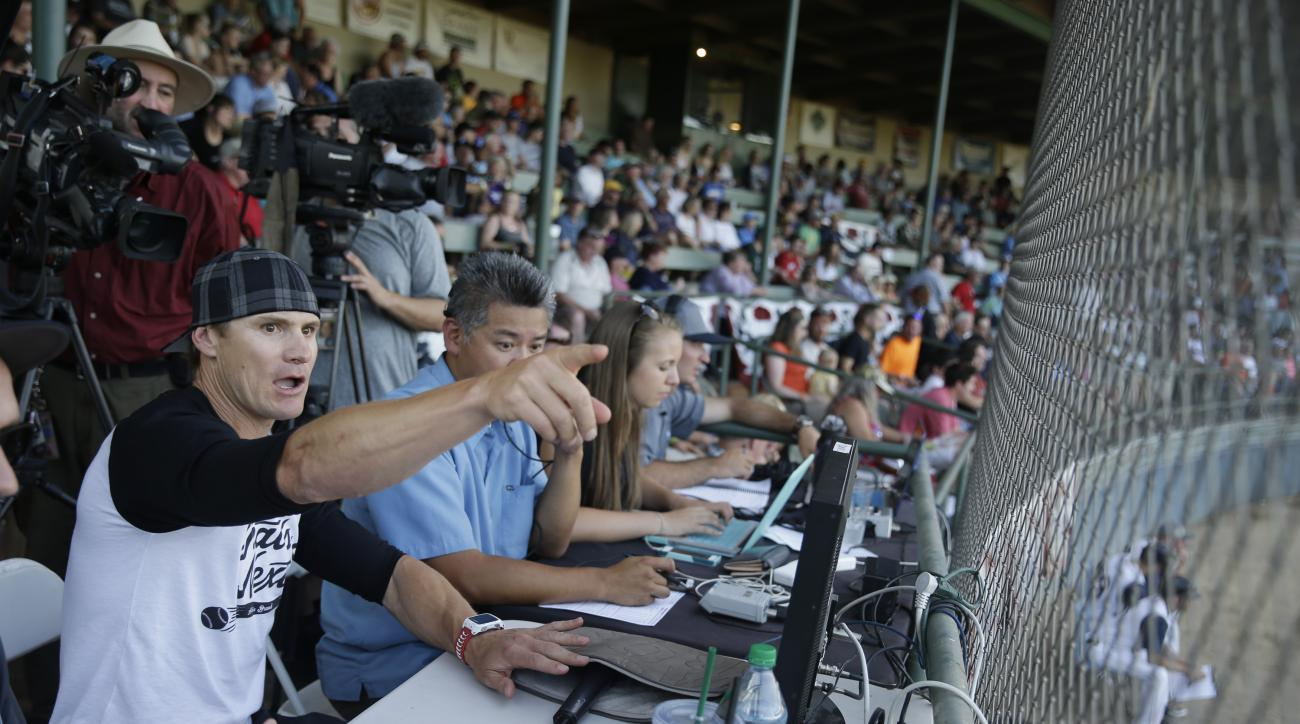 Former major league outfielder Eric Byrnes gestures while using a computerized video system to call balls and strikes at an independent minor league baseball game between the San Rafael Pacifics and Vallejo Admirals Tuesday, July 28, 2015, in San Rafael,