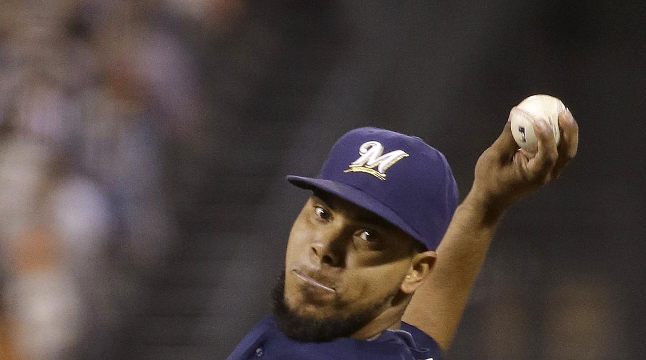 Milwaukee Brewers pitcher Wily Peralta throws against the San Francisco Giants during the fifth inning of a baseball game in San Francisco, Tuesday, July 28, 2015. (AP Photo/Jeff Chiu)