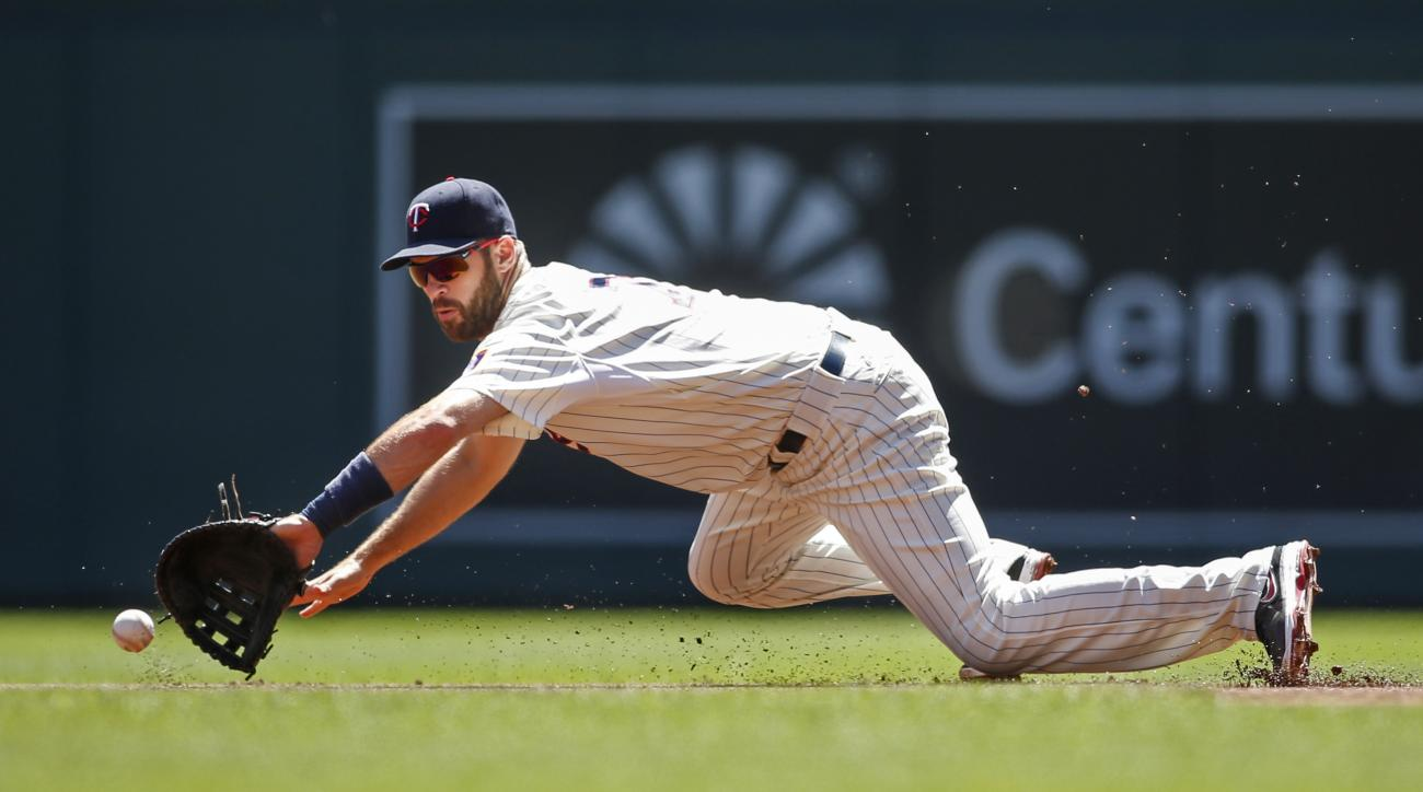 Minnesota Twins first baseman Joe Mauer fields a ball hit by Pittsburgh Pirates right fielder Gregory Polanco in the first inning of a baseball game Wednesday, July 29, 2015, in Minneapolis. (AP Photo/Bruce Kluckhohn)