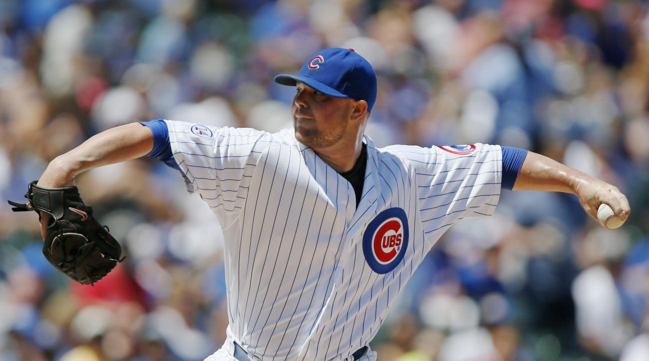 Chicago Cubs starting pitcher Jon Lester throws against the Colorado Rockies during the first inning of a baseball game in Chicago, Wednesday, July 29, 2015. (AP Photo/Andrew A. Nelles)
