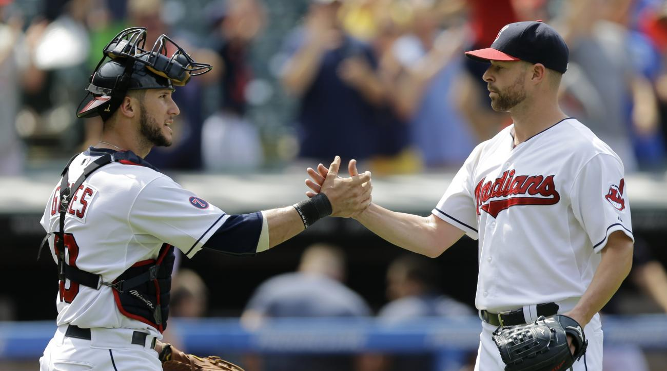 Cleveland Indians starting pitcher Corey Kluber, right, is congratulated by catcher Yan Gomes after the Indians defeated the Kansas City Royals 12-1 in a baseball game, Wednesday, July 29, 2015, in Cleveland. (AP Photo/Tony Dejak)
