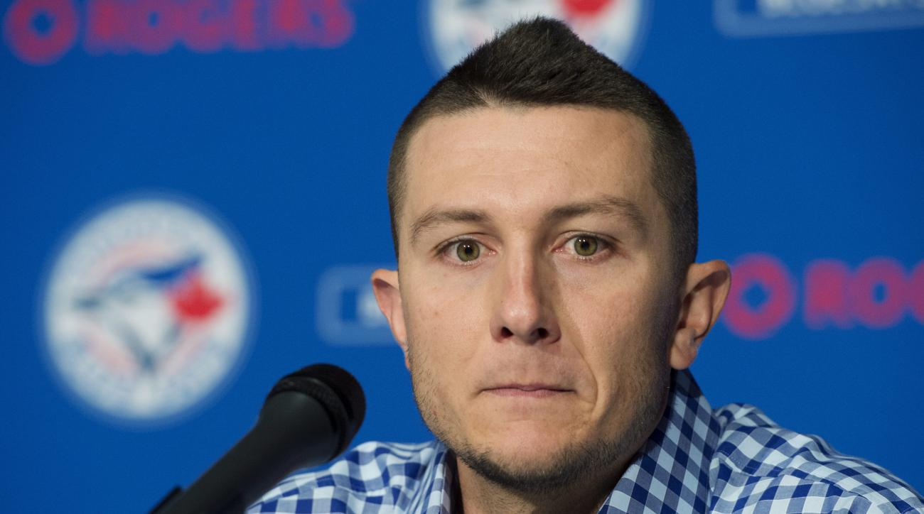 Toronto Blue Jays' newly-acquired shortstop Troy Tulowitzki speaks to reporters during a news conference in Toronto on Wednesday, July 29, 2015.  Tulowitzki and right-handed reliever LaTroy Hawkins were acquired from the Colorado Rockies. (Darren Calabres