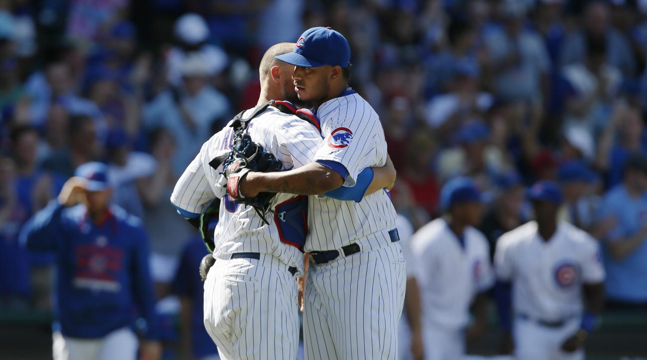Chicago Cubs relief pitcher Hector Rondon, right, celebrates with catcher David Ross after they defeated the Colorado Rockies in a baseball game in Chicago, Wednesday, July 29, 2015. The Cubs won 3-2. (AP Photo/Andrew A. Nelles)